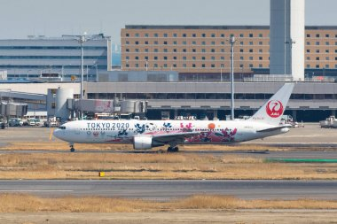 March 18, 2020, Tokyo, Japan - Japan Airlines (JAL) aircraft with logos of Tokyo Olympic Games 2020 (Tokyo 2020) is seen in Tokyo International Airport commonly known as Haneda Airport.