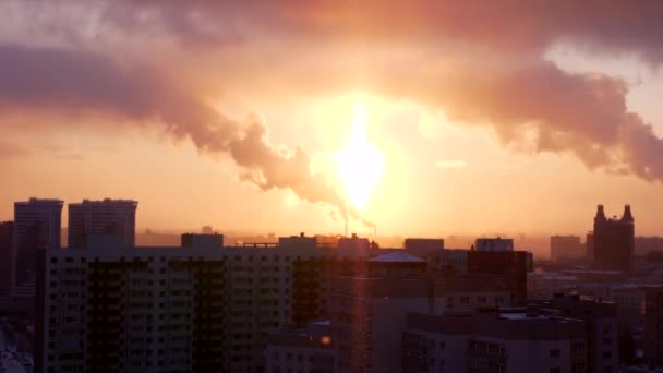 Modern City View in Sunset with Winter Snow and Smoking Industrial Pipes