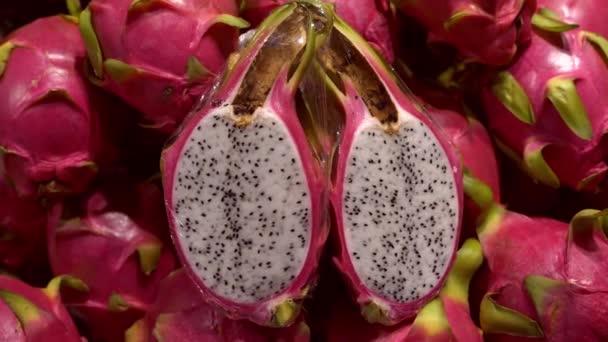 Pile of Red Pitahaya or Dragon Fruit or Pitaya with 1 Pitahaya Sliced
