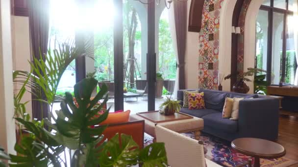 Spanish Style Modern Residential Condominium with Large Windows in the Sunset