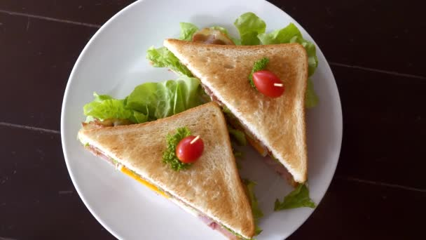Top View of Two Sandwiches with Toasted Bread, Ham, Cheese, Egg, Lettuce, Bacon