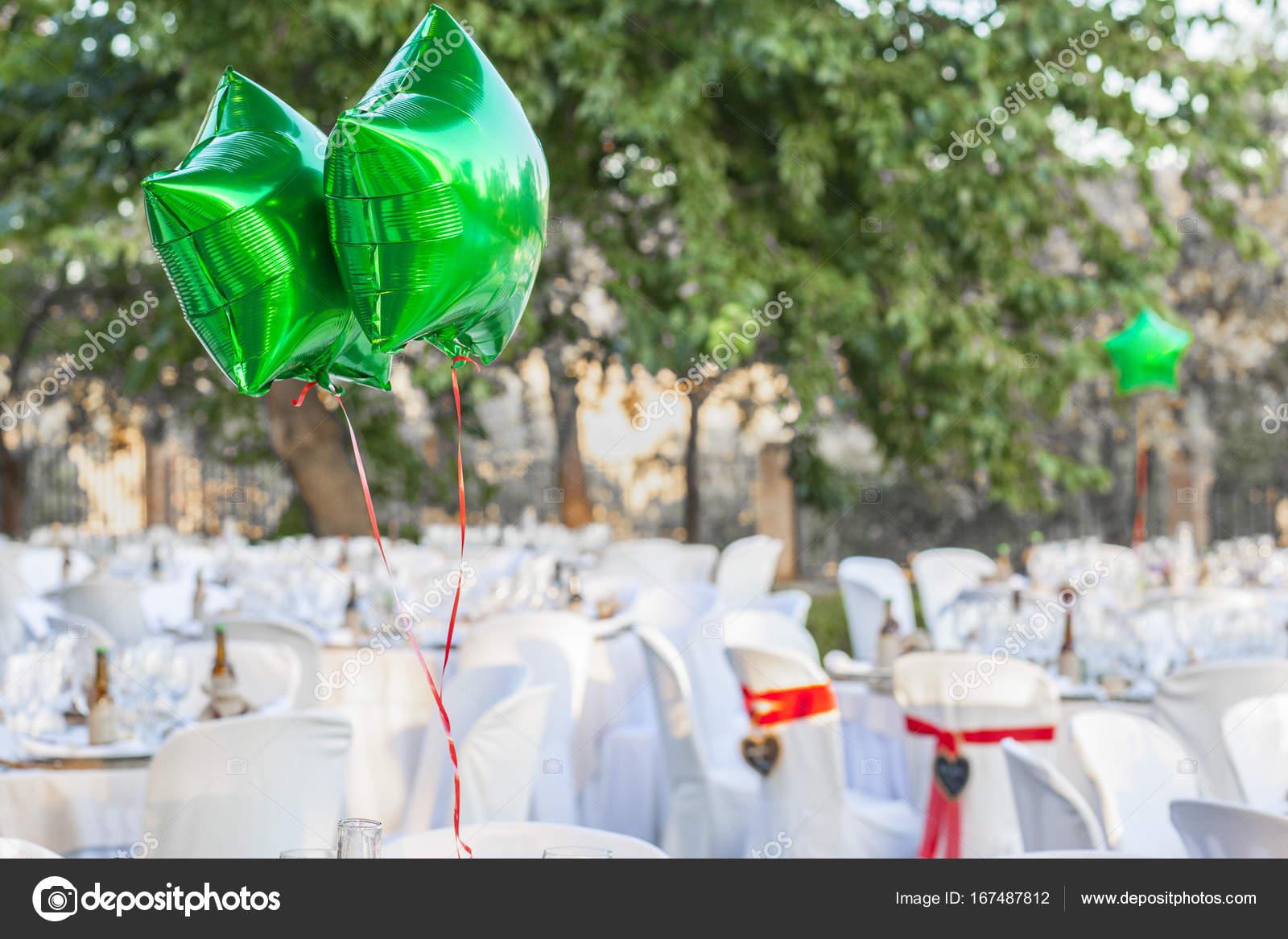 Green shiny balloons at garden table setting for wedding recepti u2014 Stock Photo & Green shiny balloons at garden table setting for wedding recepti ...