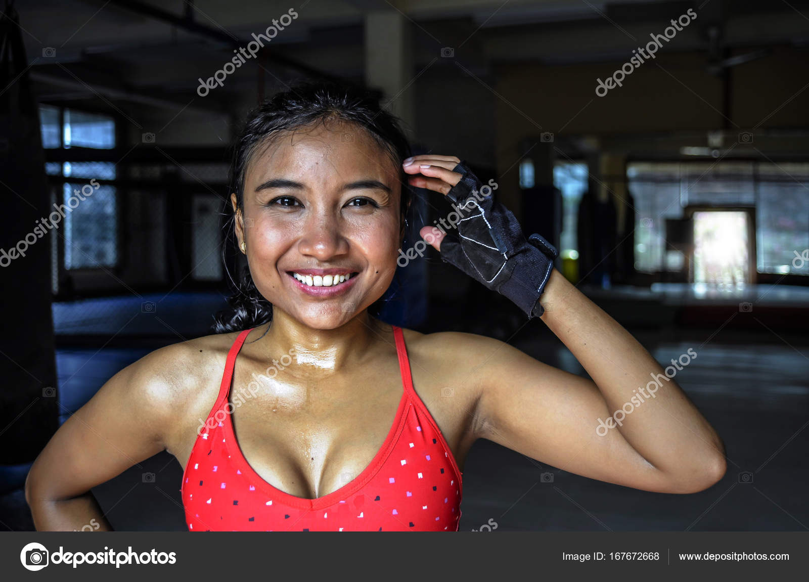 cfeffce7262 Corporate portrait of happy beautiful and sweaty young Asian woman in sport  training cloths smiling relaxed at gym dojo after workout exercise in  fitness ...