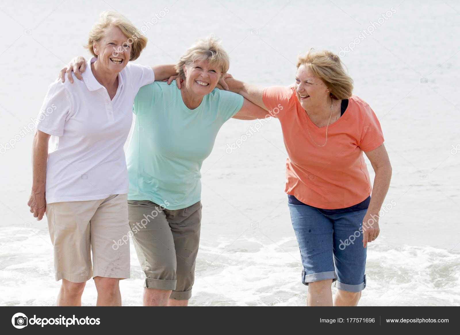 lovely group of three senior mature retired women on their 60s