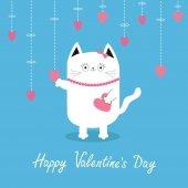 Fényképek Fehér macska lógó rózsaszín szív