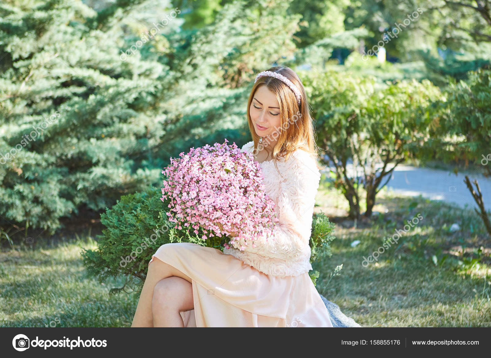 Beautiful woman with flowers stock photo malsveta 158855176 beautiful girl with bouquet of flowers in the garden pleasure sunlight and warmth beauty model woman face photo by malsveta izmirmasajfo Image collections