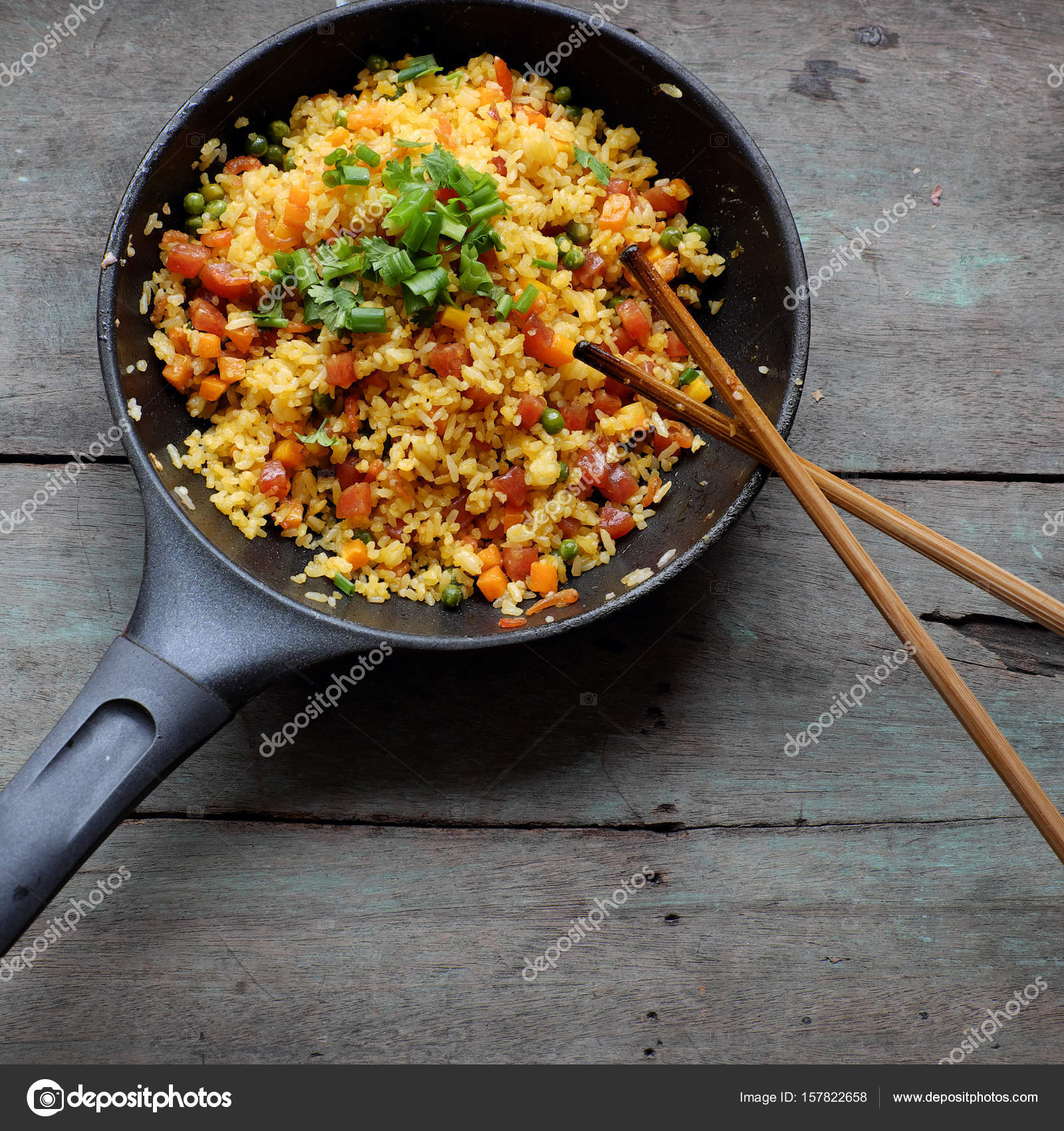Vietnam food fried rice stock photo xuanhuongho 157822658 vietnam food fried rice make from rice egg sausage dried shrimp bean cucumber tomato carrot and scallion high view of dishl on wooden background ccuart Images
