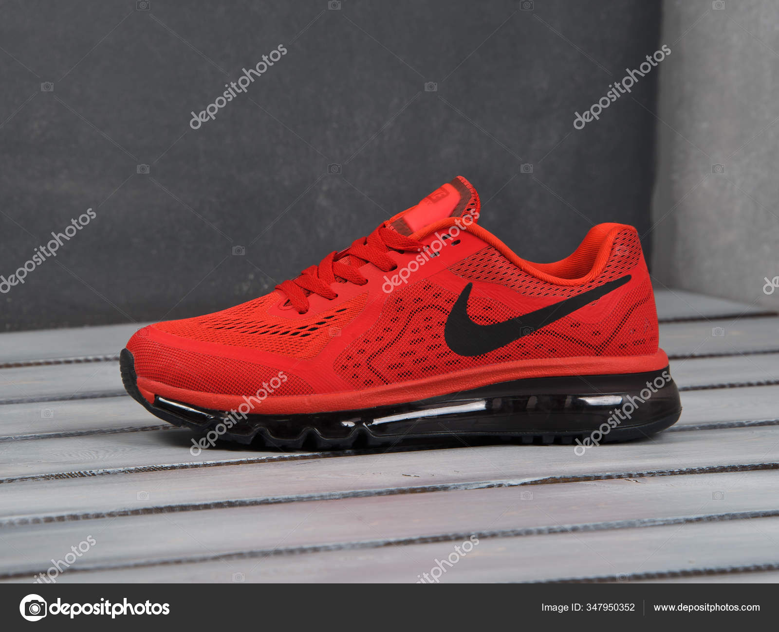 Red Nike Air Max 2014 running shoes, sneakers, trainers close up view, shot on grey abstract background. Sport and casual footwear concept. ...