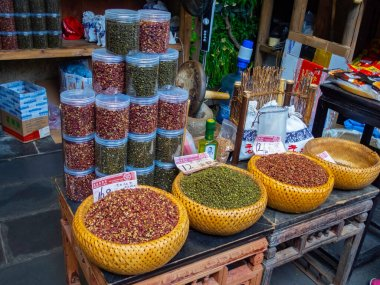 Bowls in a shop with all varieties of sichuan pepper. Chengdu city, China