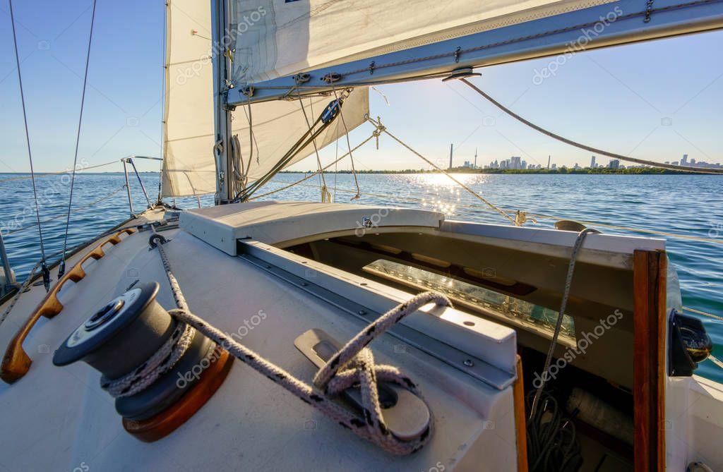 Sailboat at sea with view of horizon