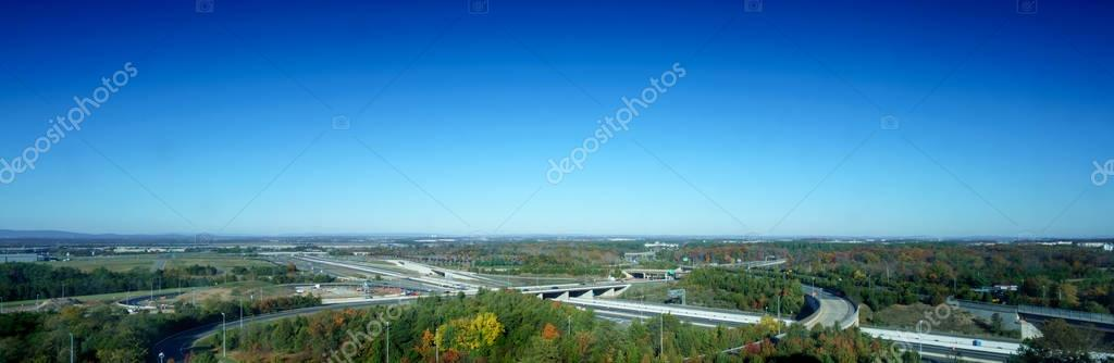 Road transport infrastructure, trees, skyline and blue sky