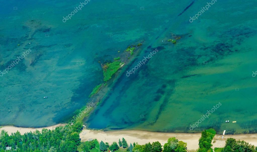 Aerial view of beach landform off coast shore
