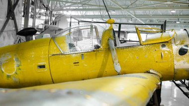 Yellow painted propeller plane