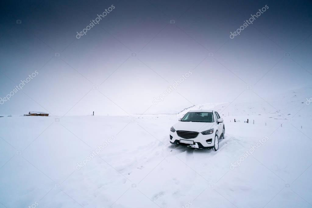 Stationary car on deep snow covered landscape