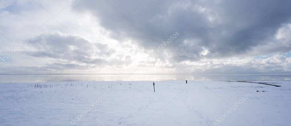 Snow covered landscape and stormy sky