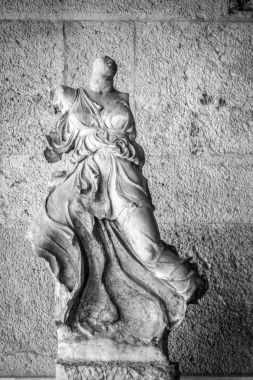 Low angle view of a broken statue of a woman, Athens, Greece
