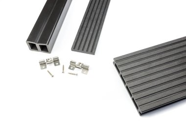 Black composite decking board with mounting material