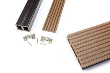 Brown composite decking board with mounting material