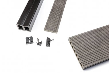 Grey composite decking board with fastening material