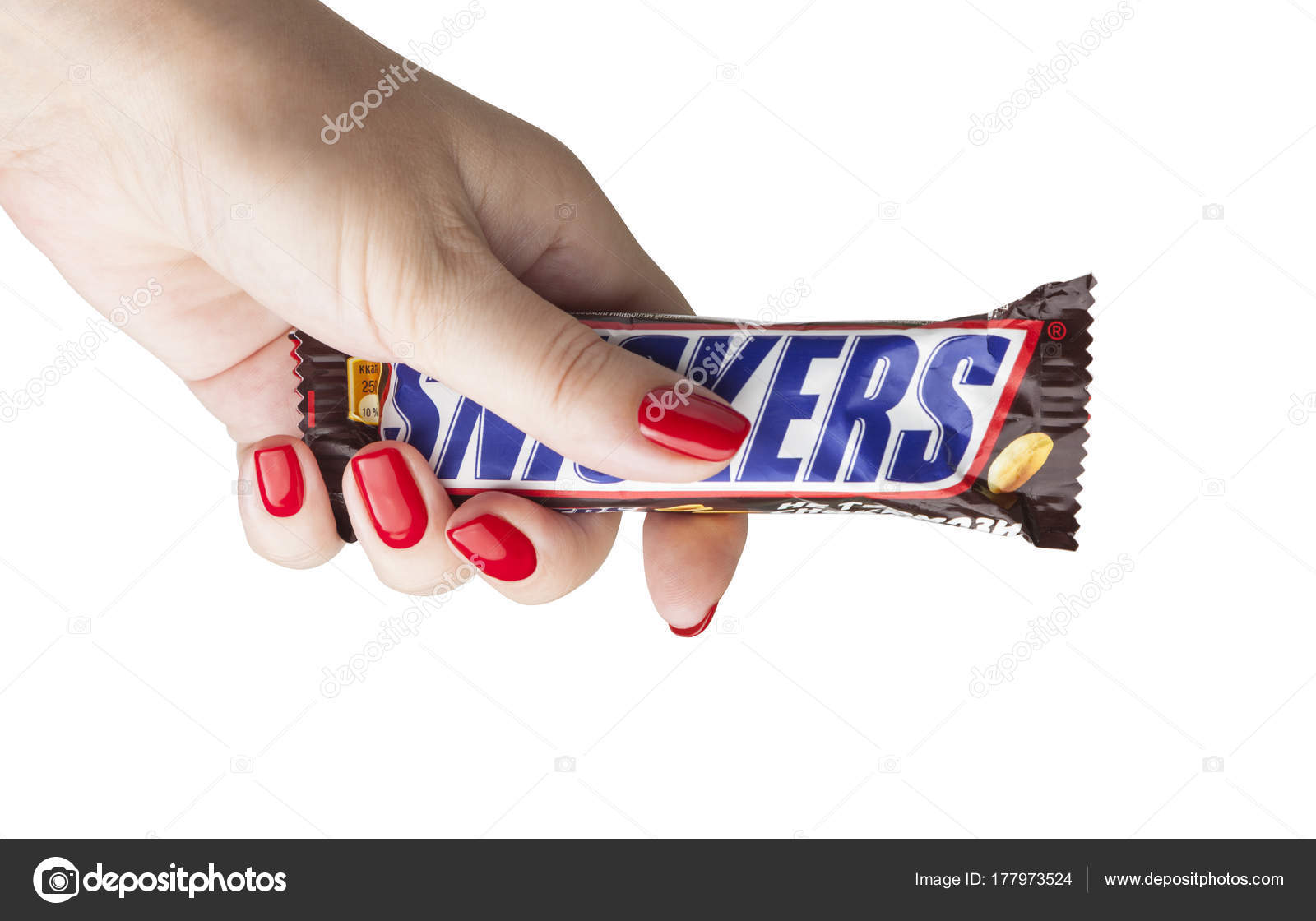Hand holding a snickers chocolate bar stock editorial photo snickers bars are produced by mars incorporated snickers was created by franklin clarence mars in 1930 photo by slaystorm buycottarizona Gallery