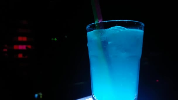 Blue Cocktail Drink on Table Close Up. Night Club Lightning Atmosphere