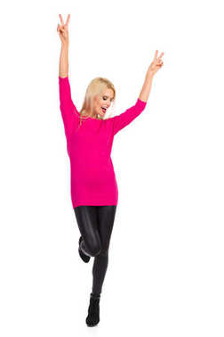 Beautiful Woman Is Dancing On One Leg With Arms Raised And Singing