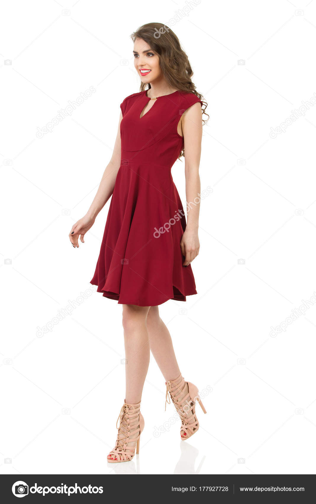 Smiling Beautiful Woman In Red Dress And High Heels Is Walking ...