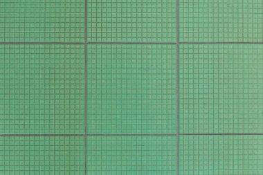 Old green floor tiles  texture background