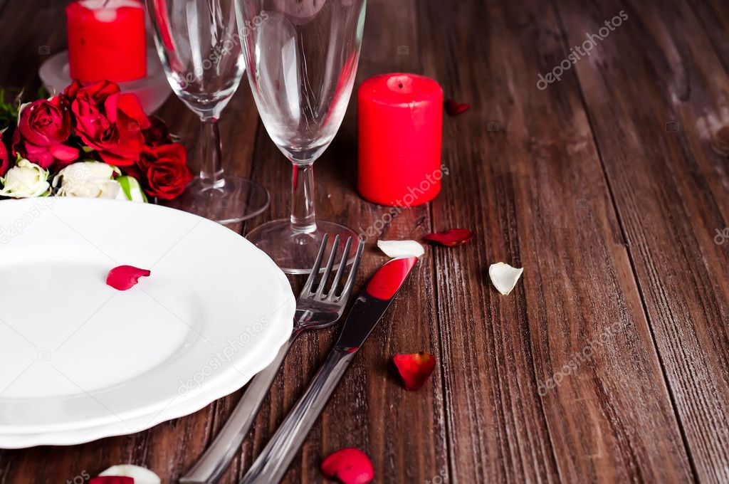 Romantic Valentine Candle Light Dinner Table Setting with red roses gift and burning candles against a brown background. \u2014 Photo by lyulka.86 & Romantic candle light Valentine Table Setting \u2014 Stock Photo © lyulka ...