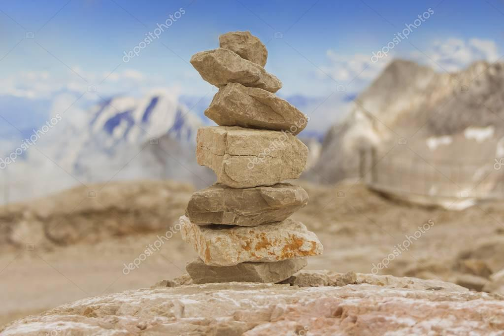 Stone tower in mountains height show balance stability power