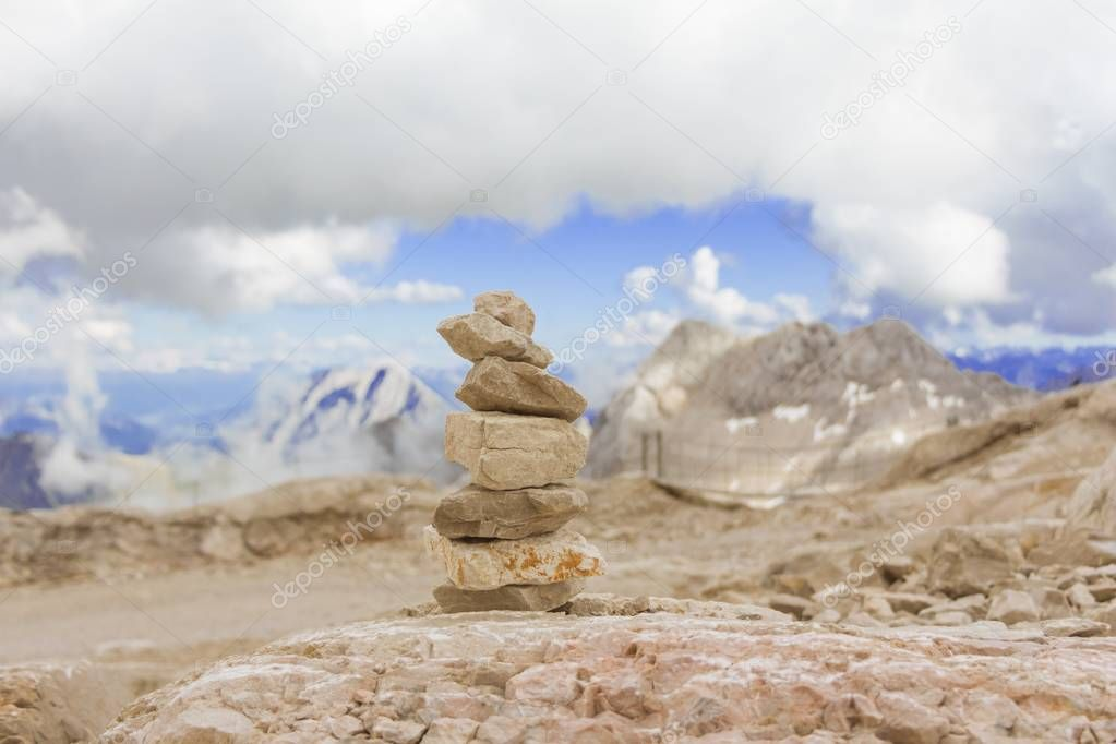 One stone tower in mountains height show balance stability power
