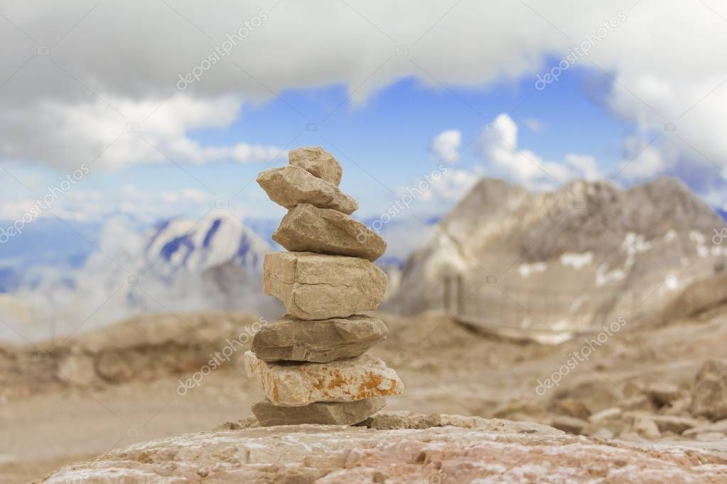 Big stone tower in mountains height show balance stability power