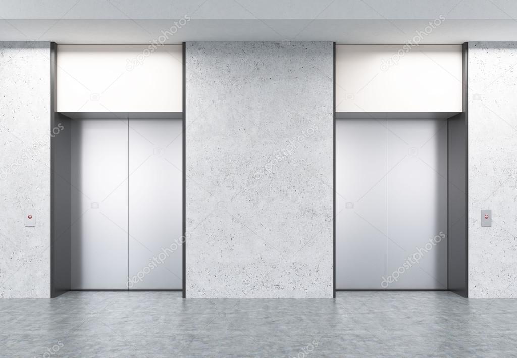 Dos ascensores cerrados en pasillo con paredes de hormigón — Foto de ...