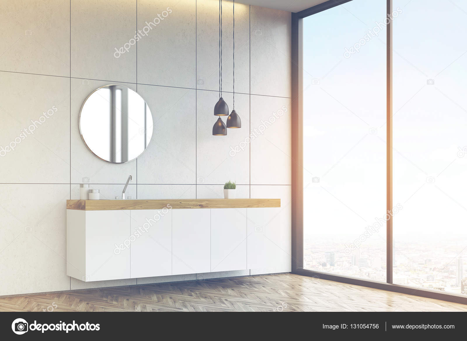 Vista laterale di un lavandino del bagno con specchio su rotondo