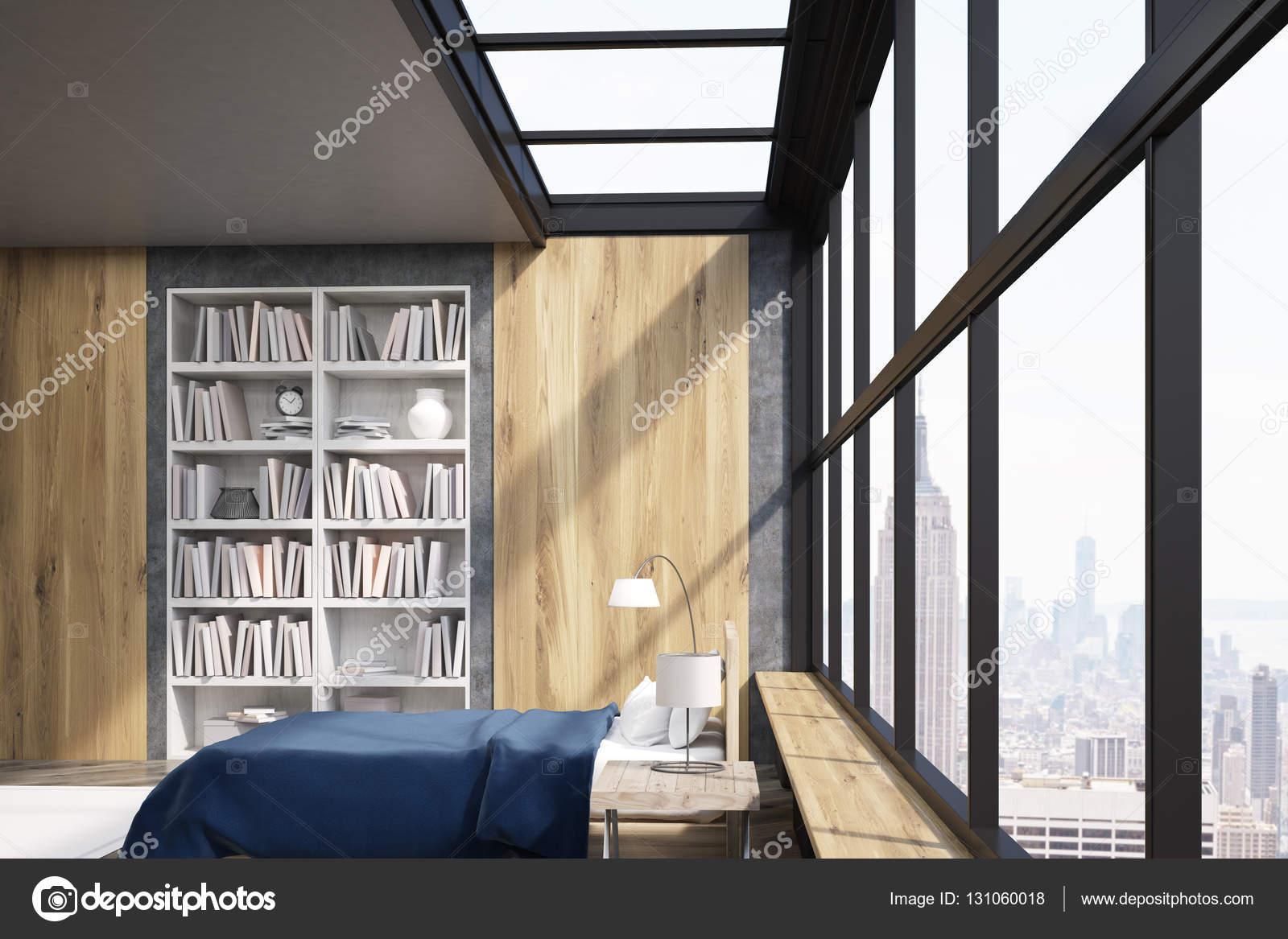 Zijaanzicht van New York slaapkamer met poster en boekenkast ...