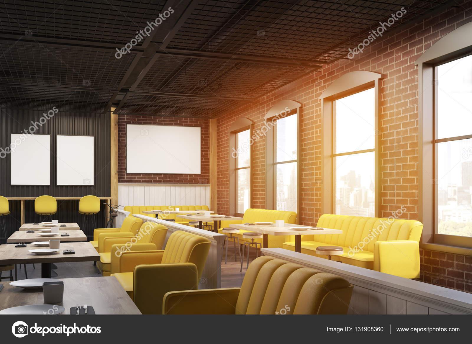cafe interieur met geel en beige banken houten tafels en bakstenen muur met affiches opknoping op hen 3d rendering mock up getinte afbeelding foto van