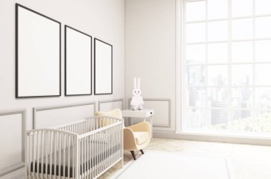 Side view of a baby's room with a hare and three vertical poster
