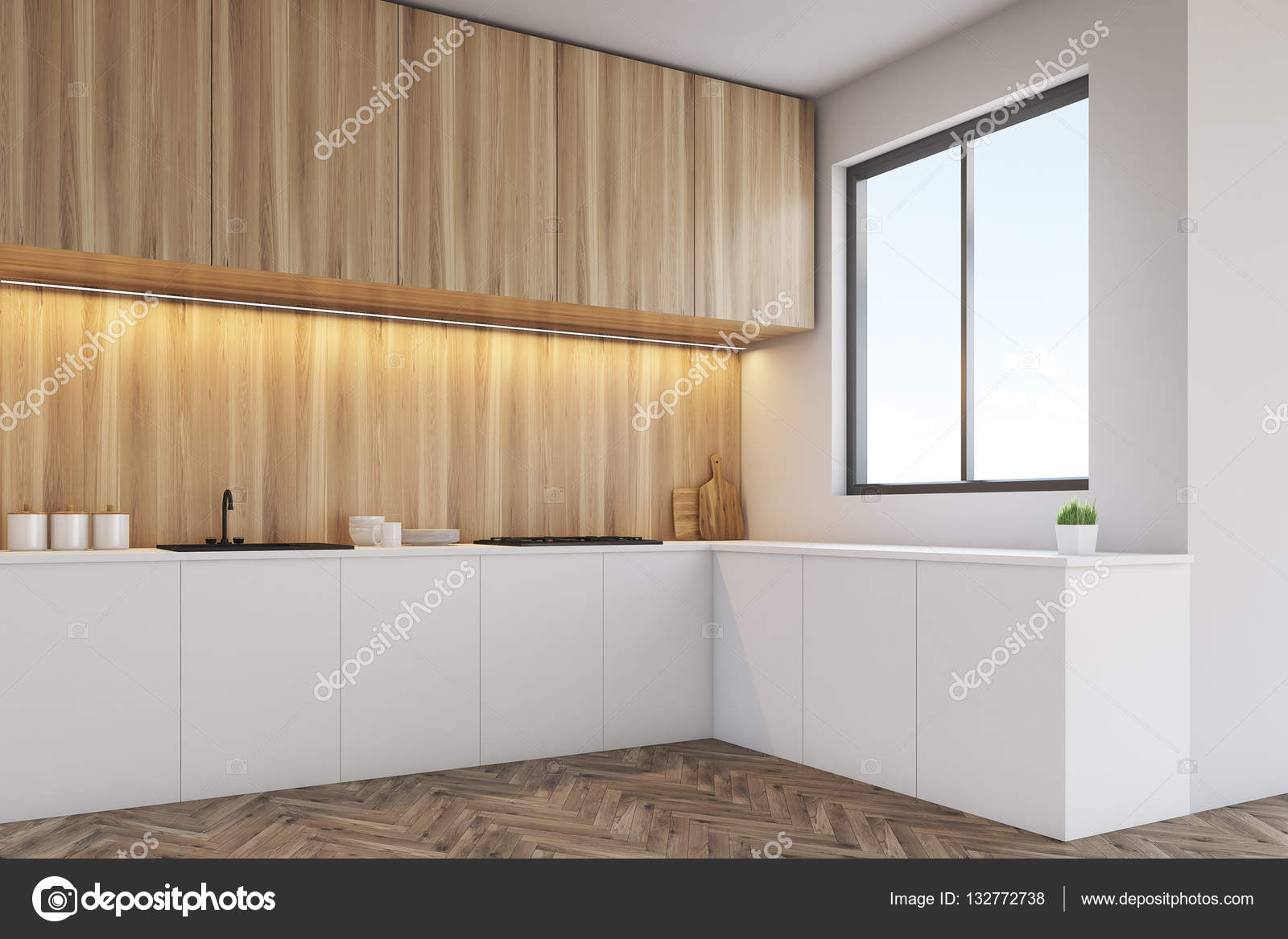 Esquina de un mostrador de cocina con muebles de madera clara ...