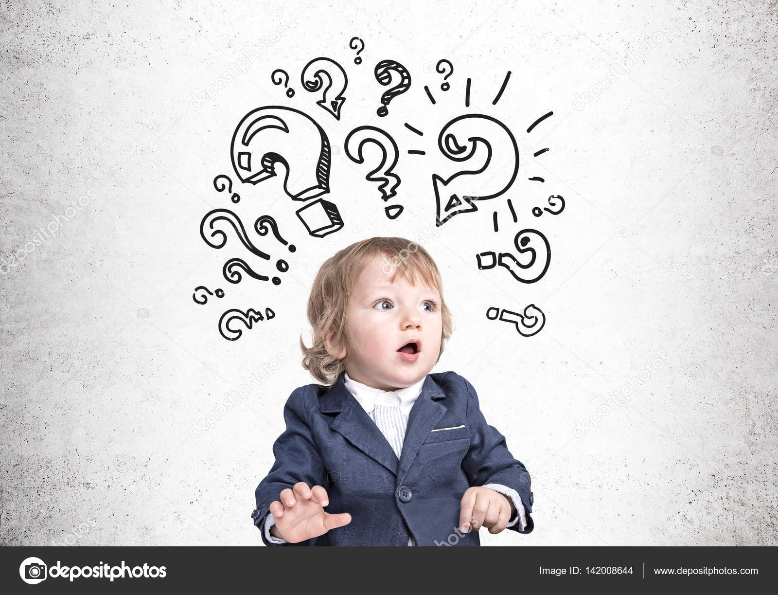 baby boy and question marks on concrete stock photo