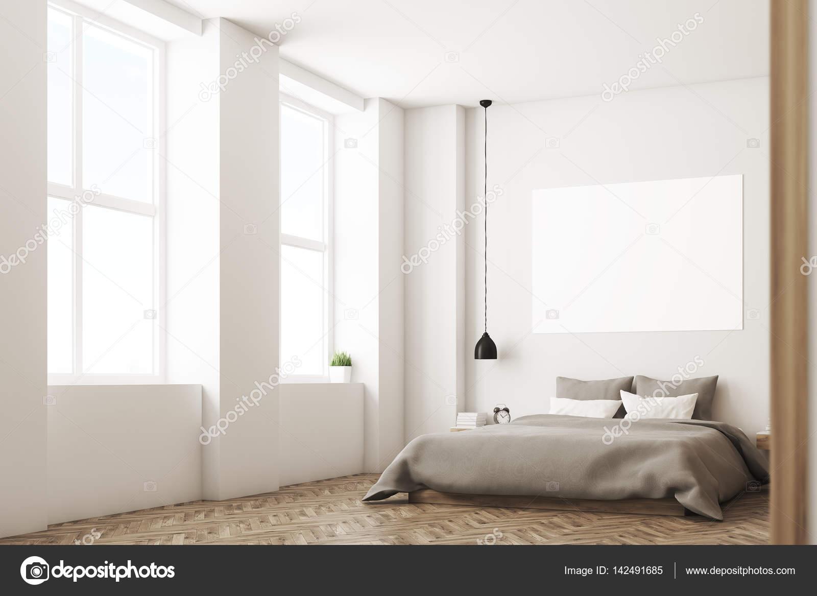 Ecke Des Inneren Schlafzimmer Mit Einem Doppelbett Ausgestattet. Bettzeug  Und Weiße Und Graue Kissen Grau. Gibt Es Eine Horizontale Plakat über Dem  Bett ...