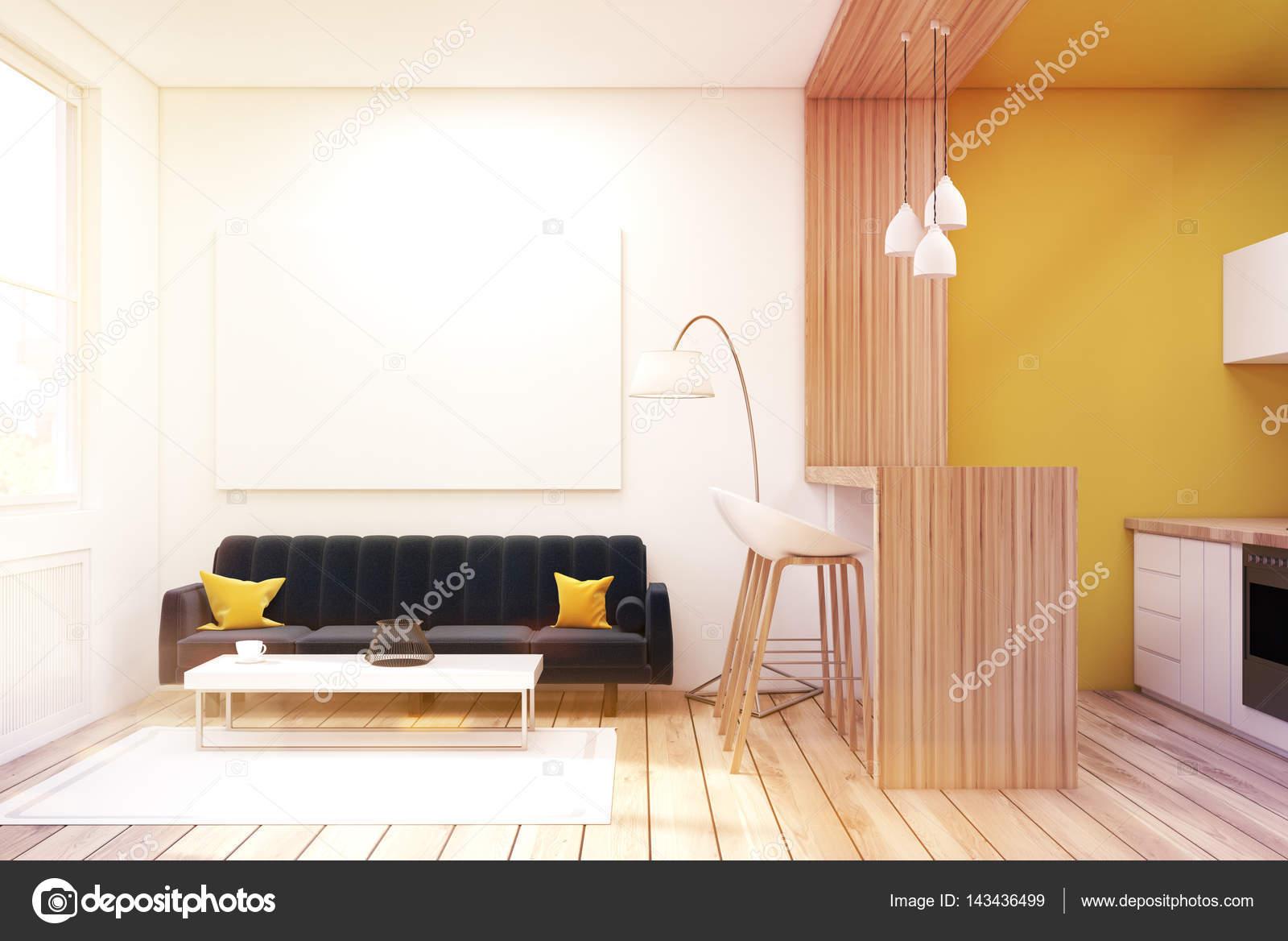 Salle de séjour avec un canapé noir dans un studio, tonique ...