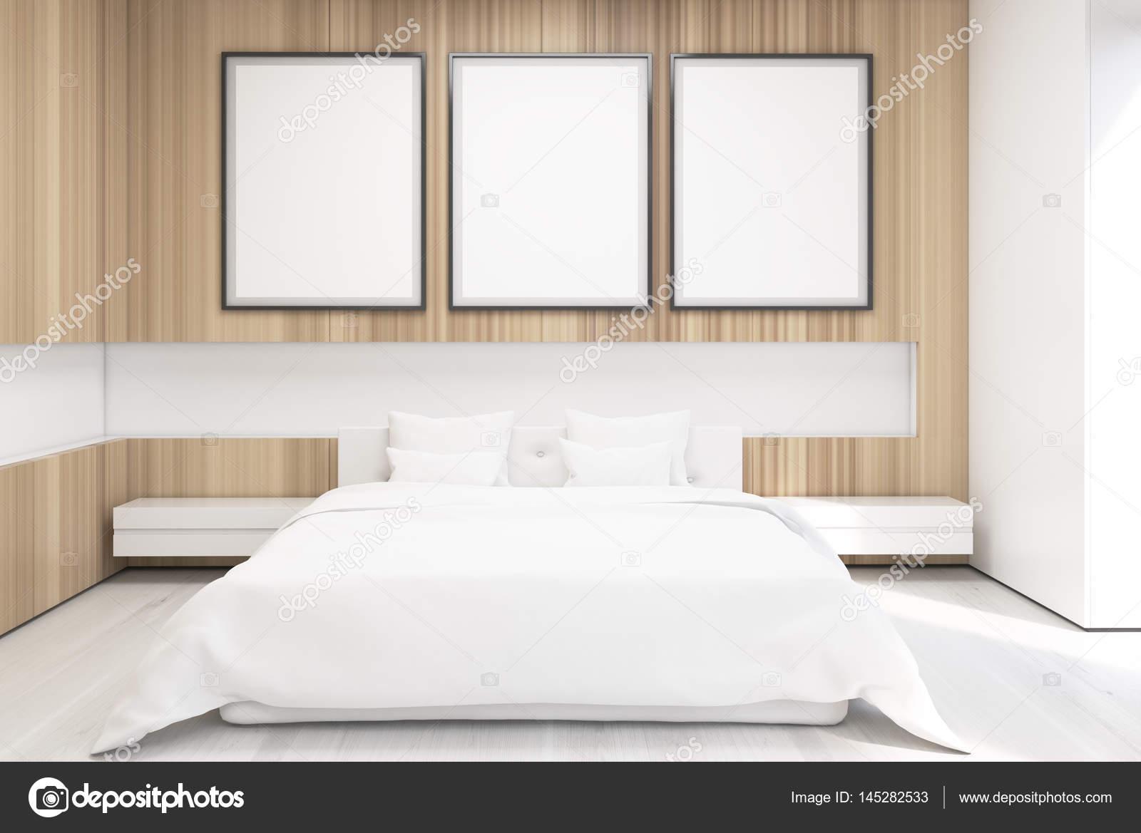 Posters In Slaapkamer : Gedessineerde deken op houten bed in grijs slaapkamer interieur