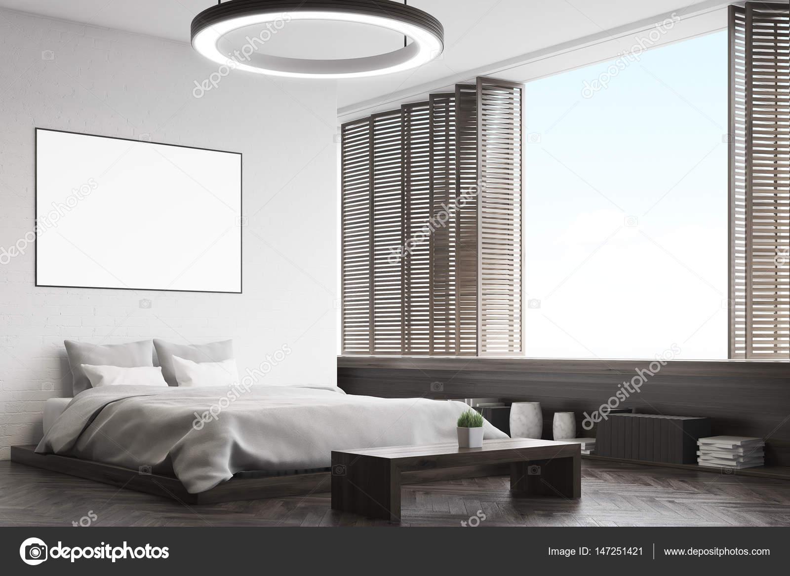 hoek van een zwarte slaapkamer met een bankje stockfoto