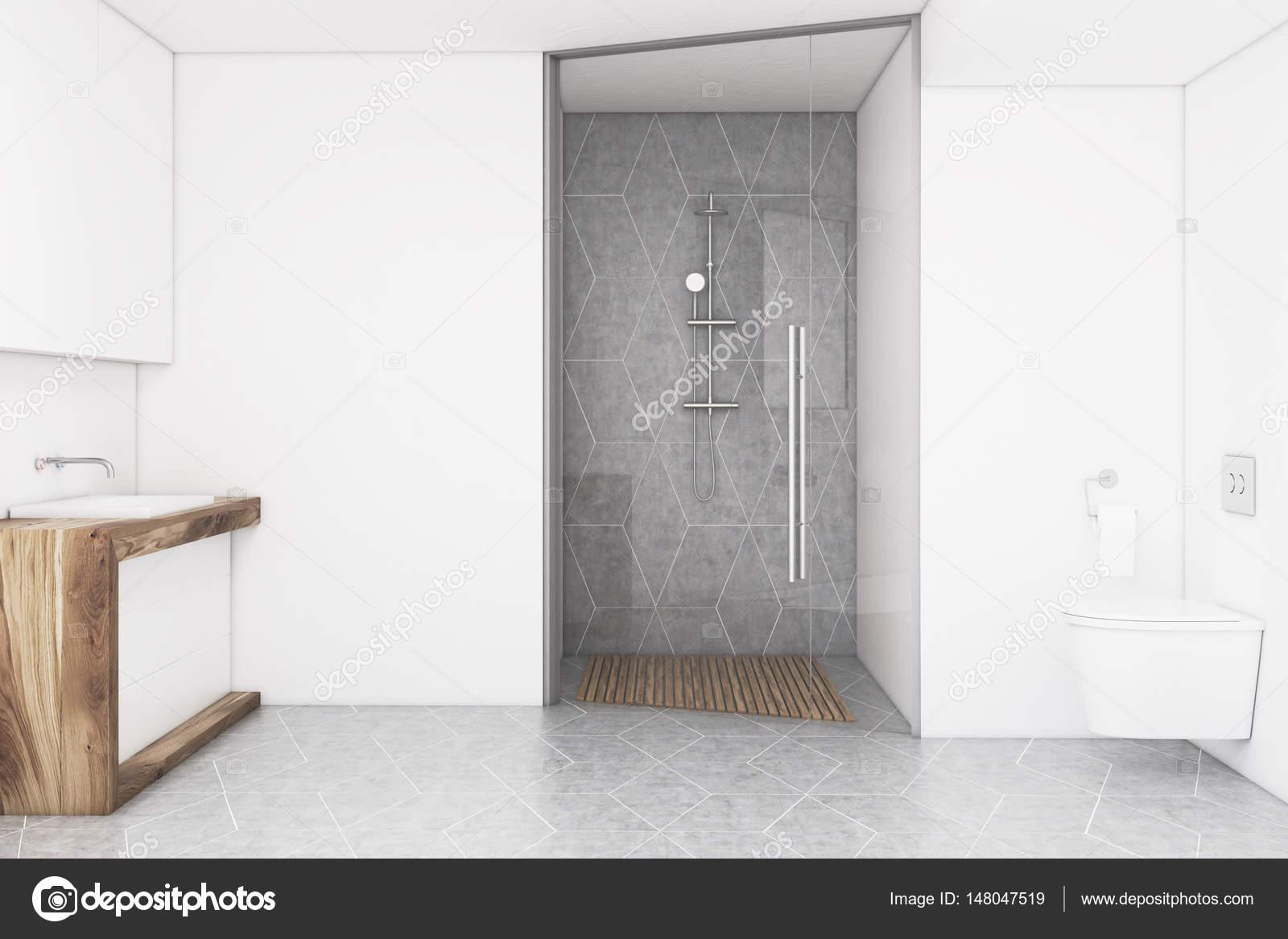 Badezimmer mit einer weißen Wand und eine Glastür ...