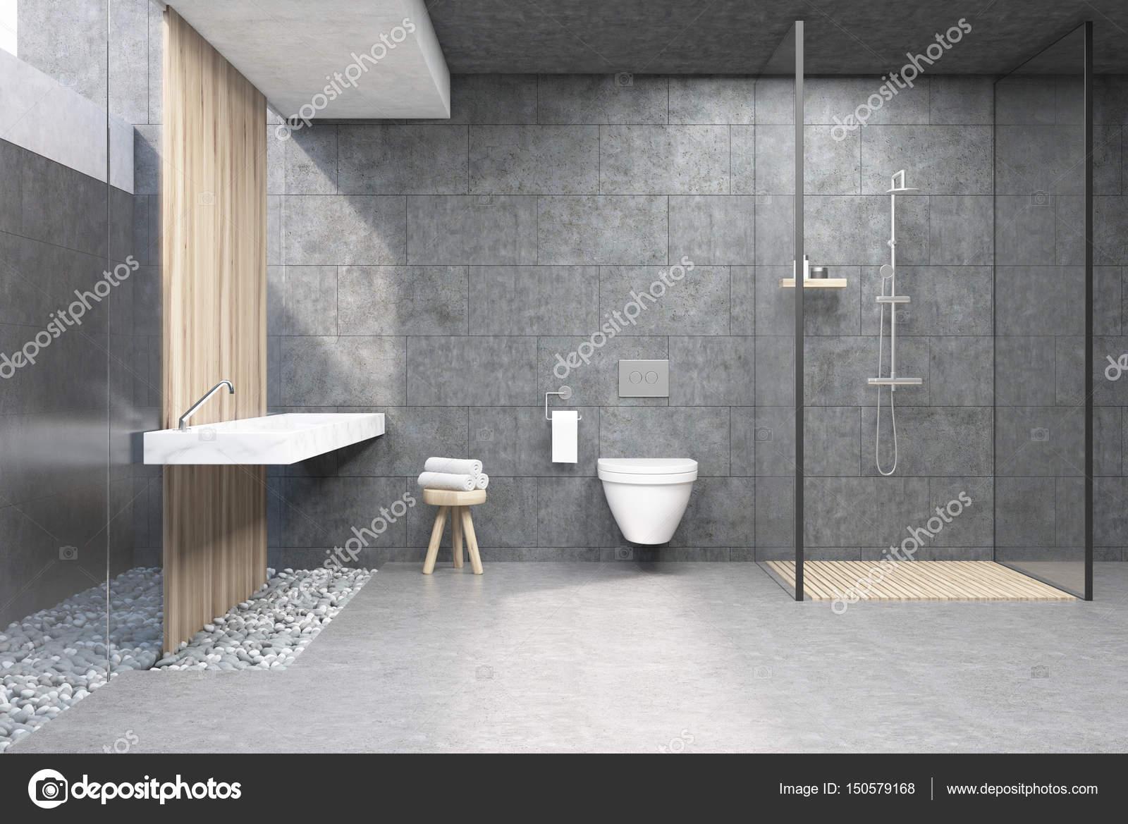 Badkamer interieur met grijze wanden, een douchecabine met glazen ...