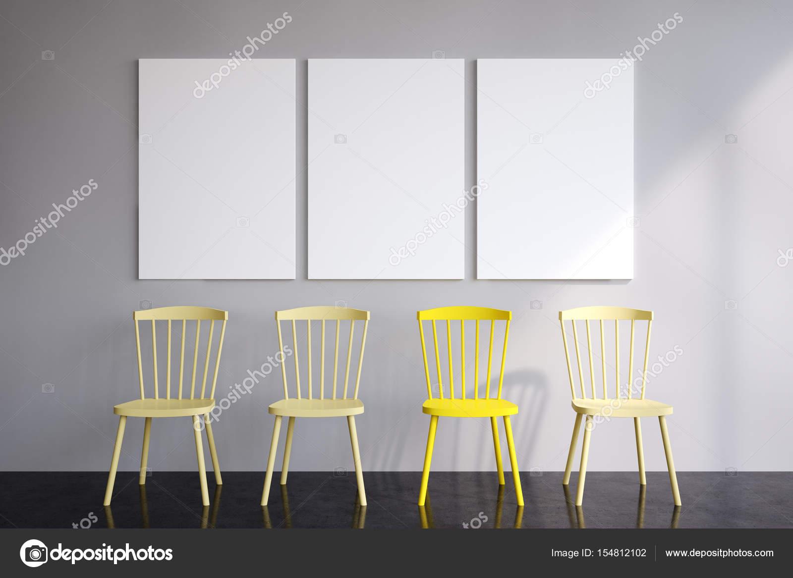 Stühle An Die Wand Hängen drei poster und gelbe stühle stockfoto denisismagilov 154812102