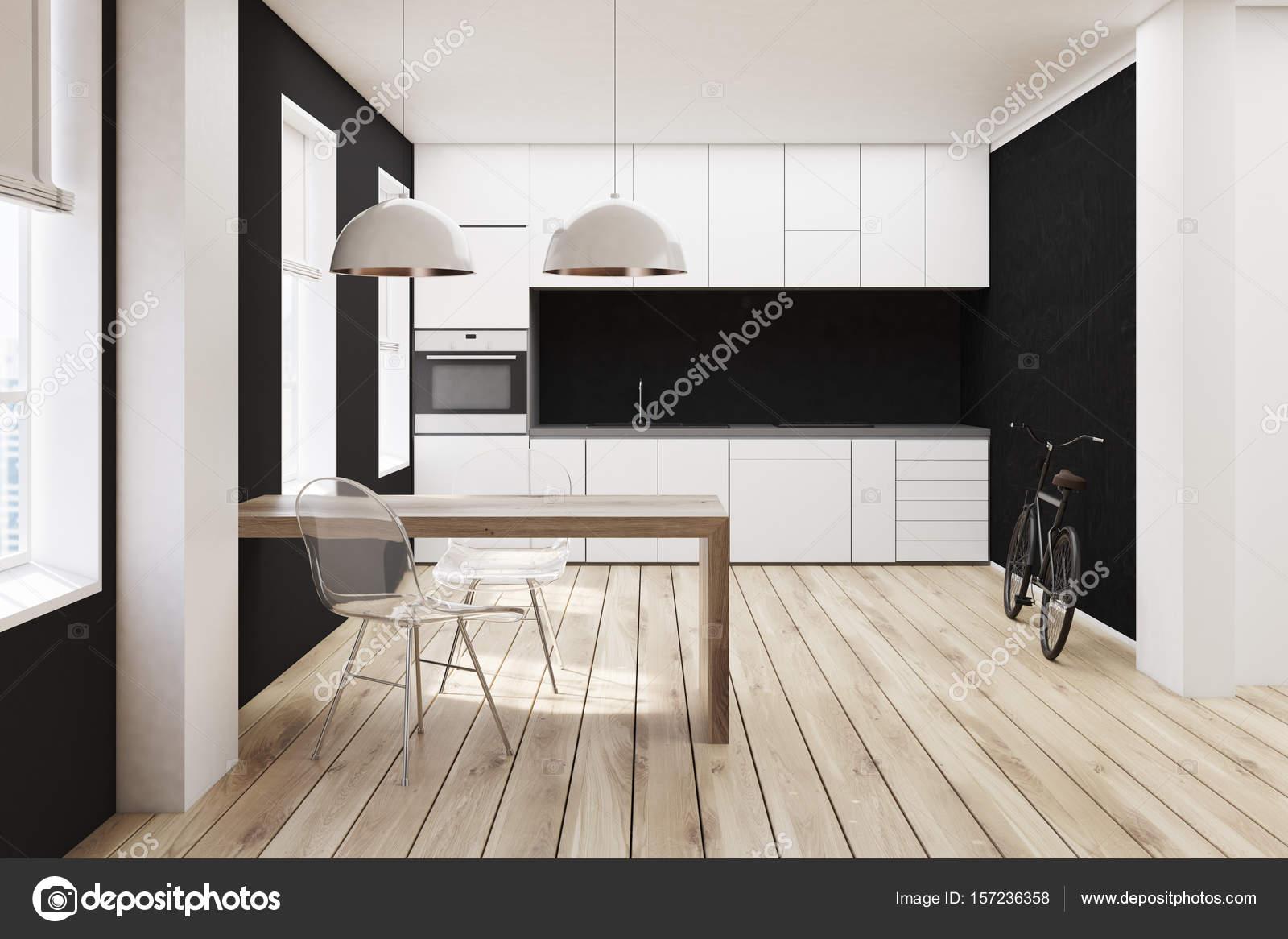 Witte en zwarte keuken houten vloer u stockfoto denisismagilov