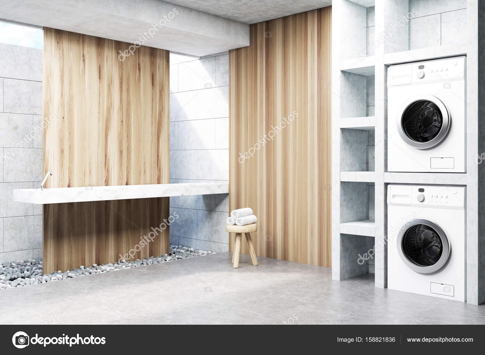 Grijze wasserij kamer wasmachine houten hoek u stockfoto