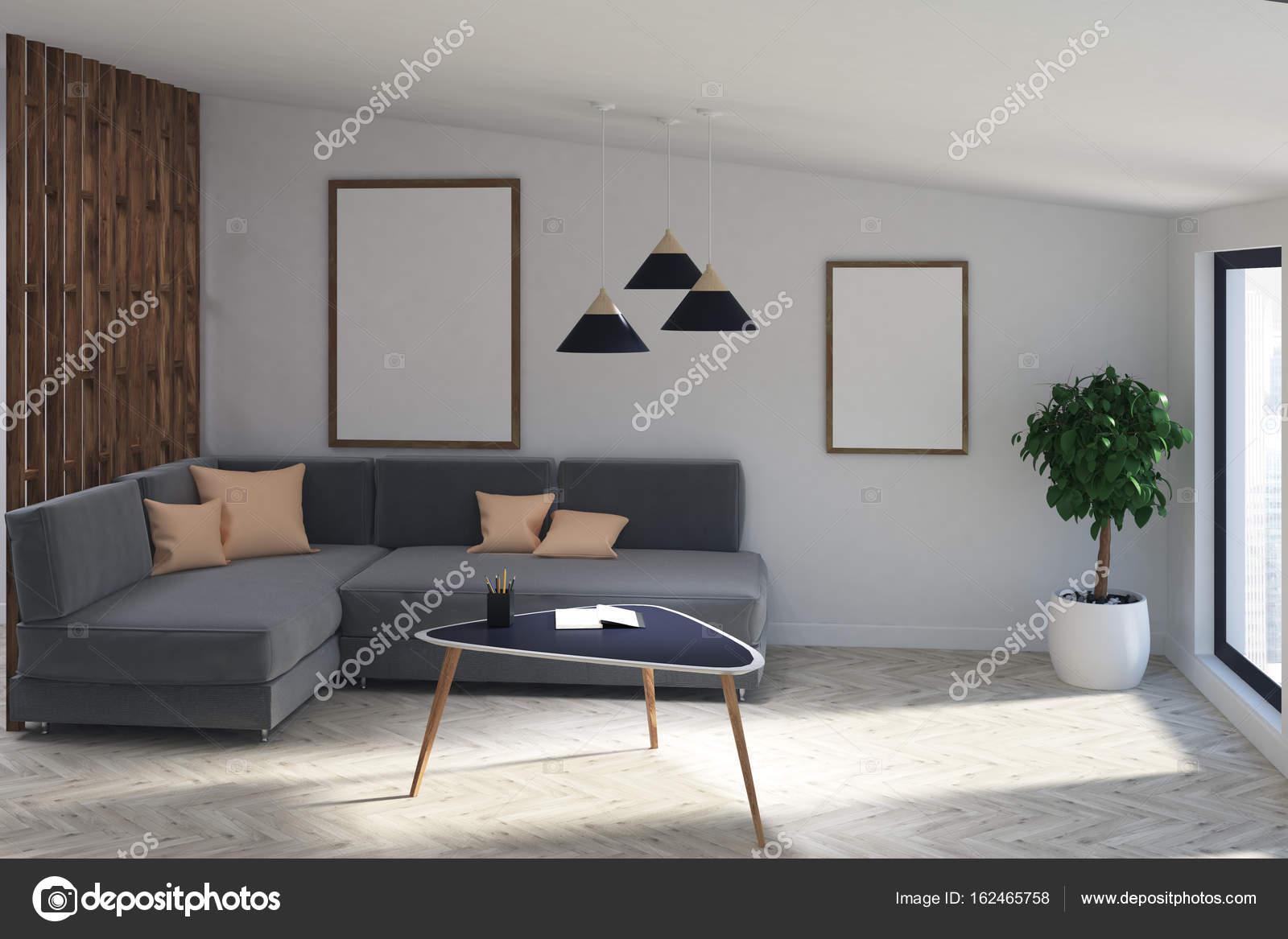 Grijze bank woonkamer met twee posters, boom — Stockfoto ...