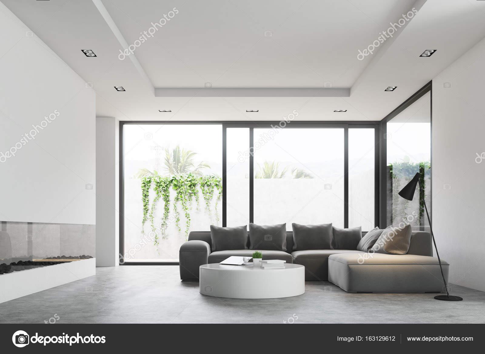 https://st3.depositphotos.com/2673929/16312/i/1600/depositphotos_163129612-stockafbeelding-woonkamer-ronde-tafel-bank-zijaanzicht.jpg